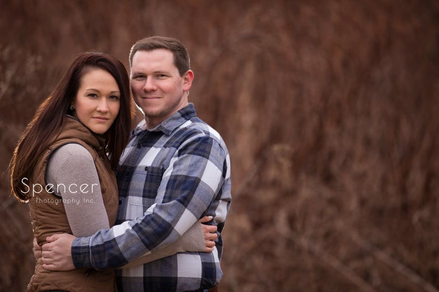 engagement session in Peninsula Ohio couple hugging