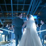 Bride and groom entering their wedding reception at Akron Art Museum