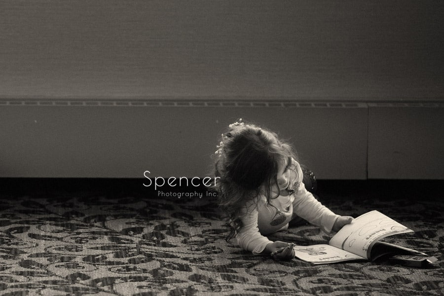 flower girl ready book in ballroom of shady hollow