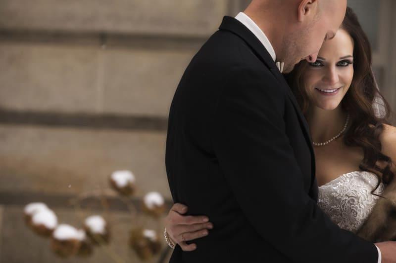 groom and bride hugging outside ballroom at park lane
