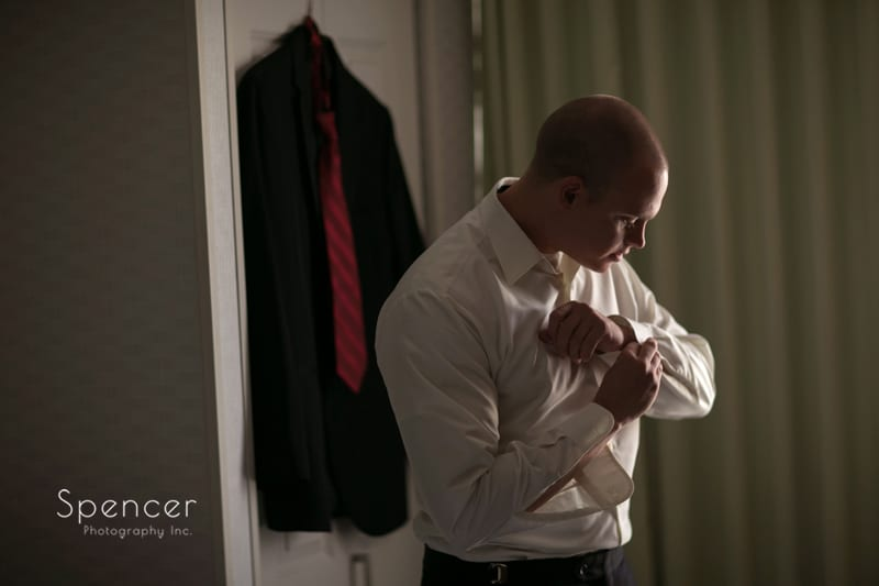 groom dressing for his wedding at thorncreek winery