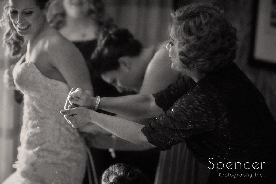 mom grabbing brides hand