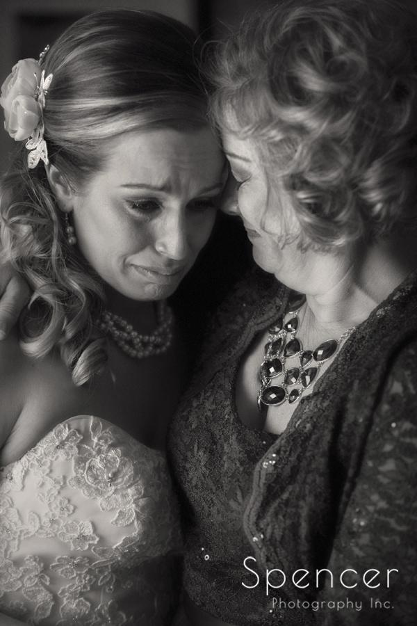 mom comforting crying bride