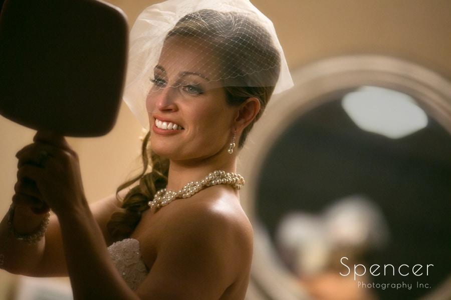 bride checking veil in mirror