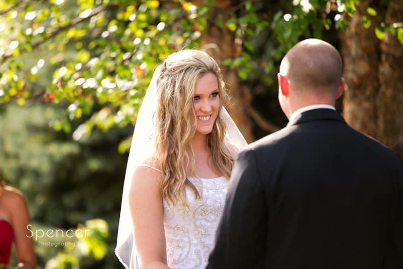 bride smiling at groom at wedding thorncreek winery