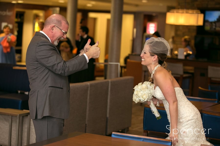 father of the bride gives her thumbs up