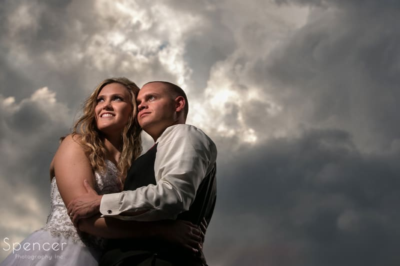 bride and groom wedding picture with clouds at thorncreek