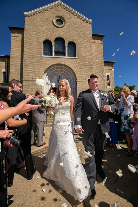 bride and groom exit church in cuyahoga falls ohio