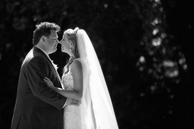 black and white picture of bride and groom in park at cuyahoga falls
