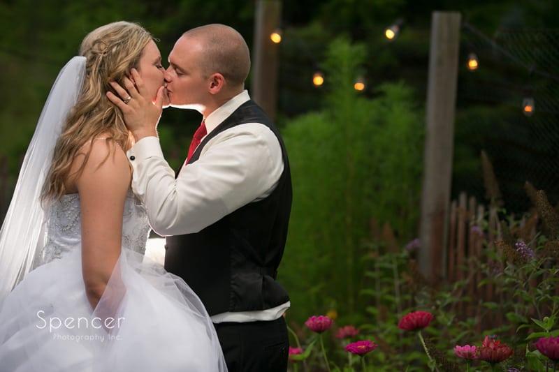 groom kissing bride at thorncreek winery reception