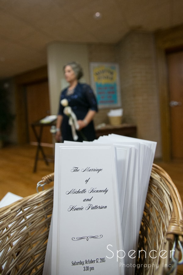 picture of wedding programs in foreground