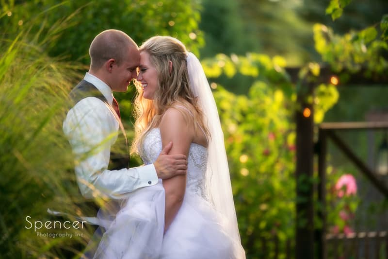 bride and groom laughing in wedding picture at thorncreek winery