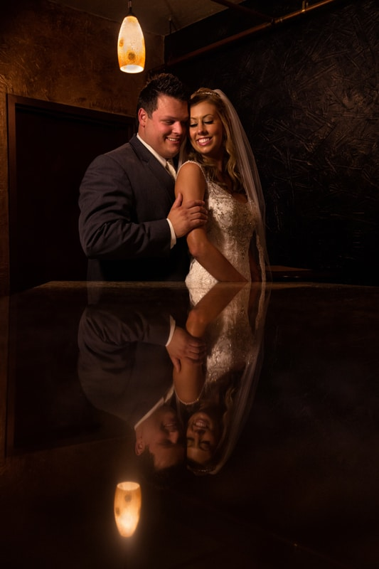 bride and groom picture in reflection at bar in cashmere cricket