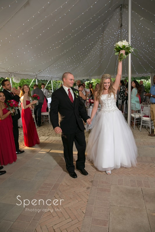 bride and groom enter their reception at thorncreek winery