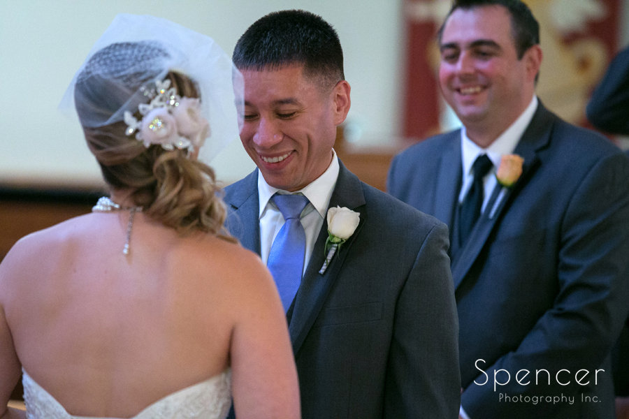 groom smiling at bride at wedding in Canton