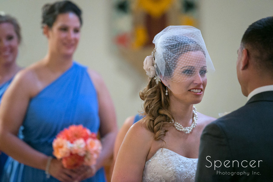 bride smiling at groom at wedding in Canton