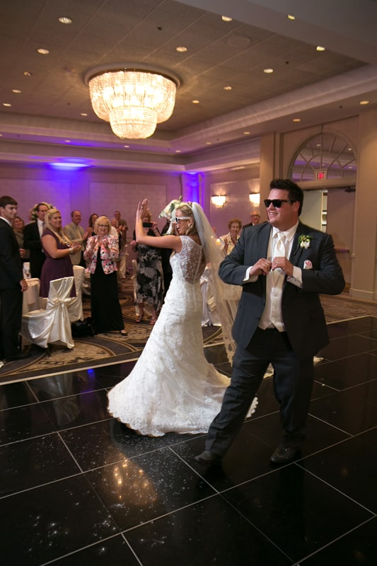 bride and groom enter their wedding reception at cuyahoga falls sheraton