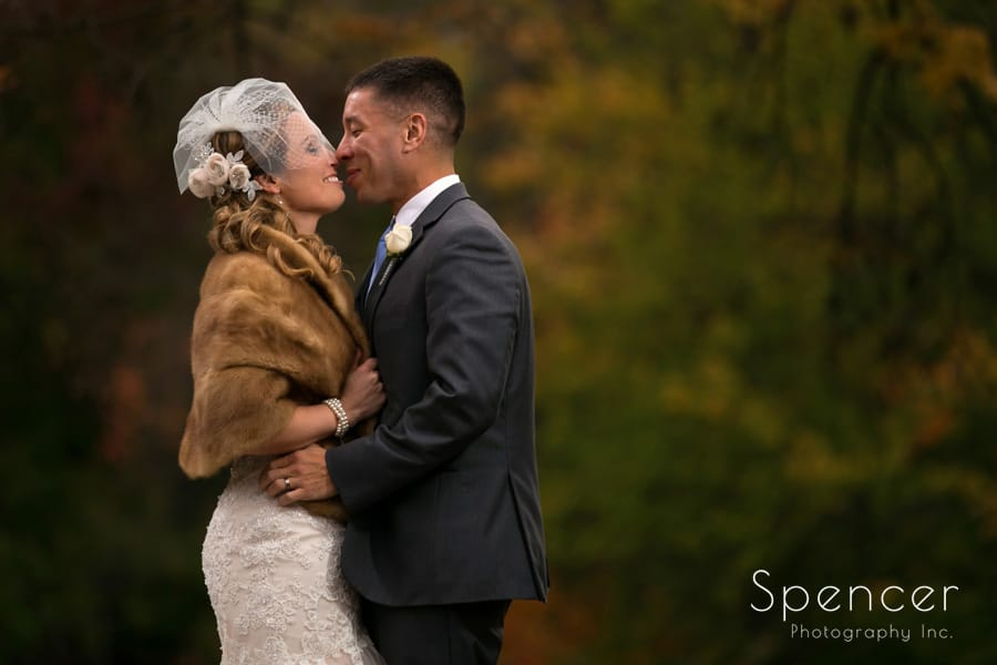 autumn wedding picture of bride and groom kissing