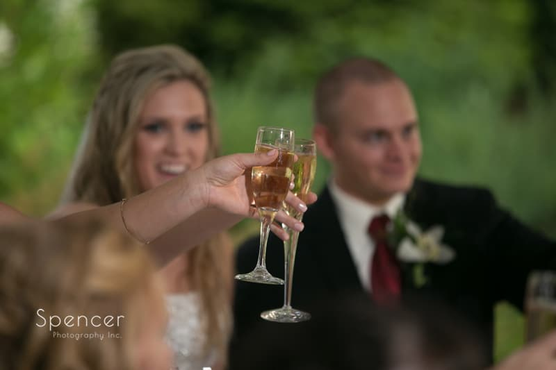 bride and groom toasting at their reception at thorncreek winery