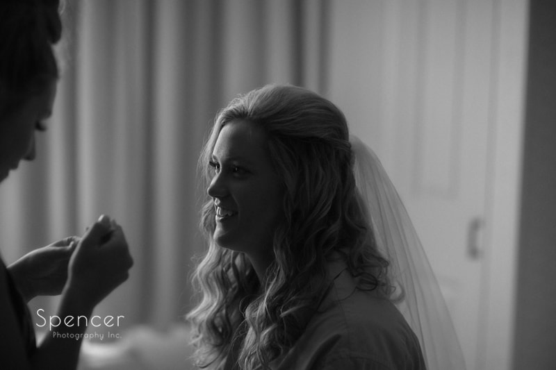 bride getting make up done at bertramz