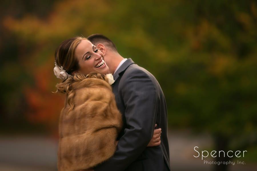 groom kissing brides neck after autumn wedding