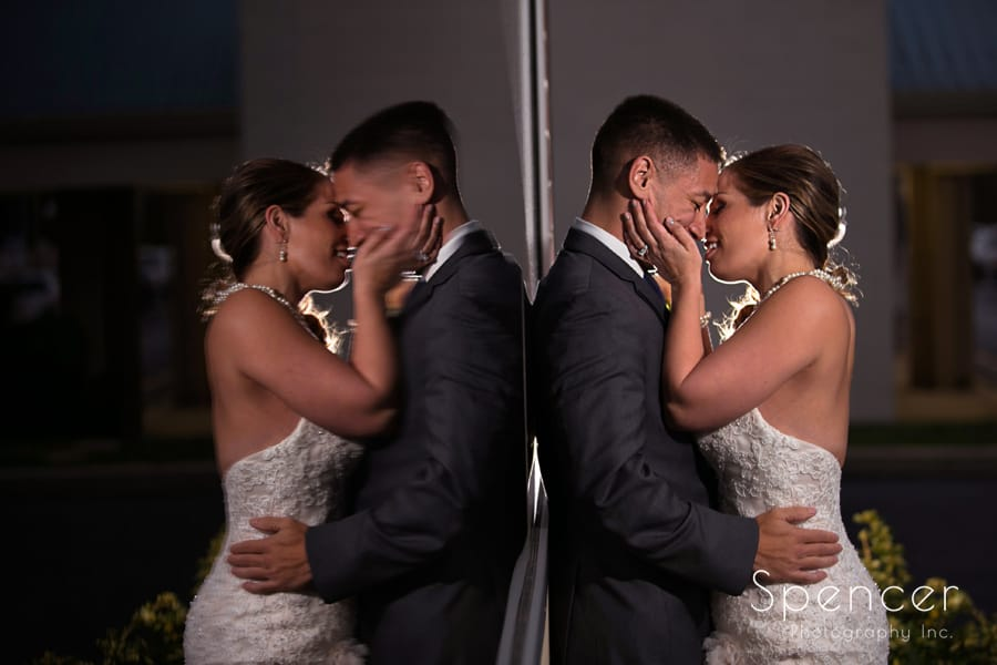 bride and groom kiss before their wedding reception at la pizzaria