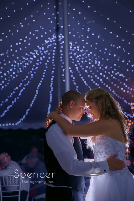 first dance with cafe lights at reception at thorncreek