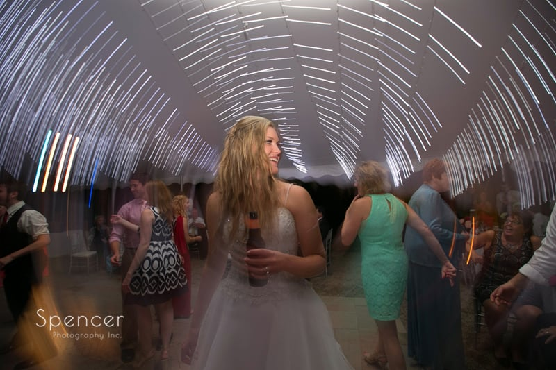 bride dancing at reception at thorncreek winery