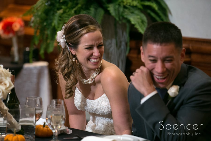 bride and groom laughing at their wedding reception in Canton, Ohio