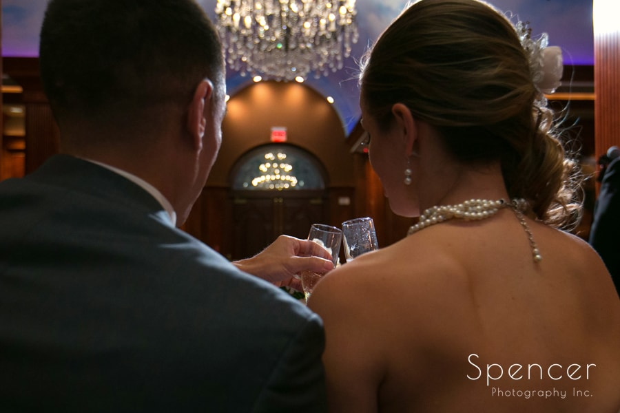 bride and groom toast at their wedding reception at la pizzaria