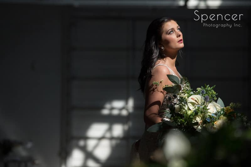 picture of bride in Madison of Cleveland posing in direct sunlight