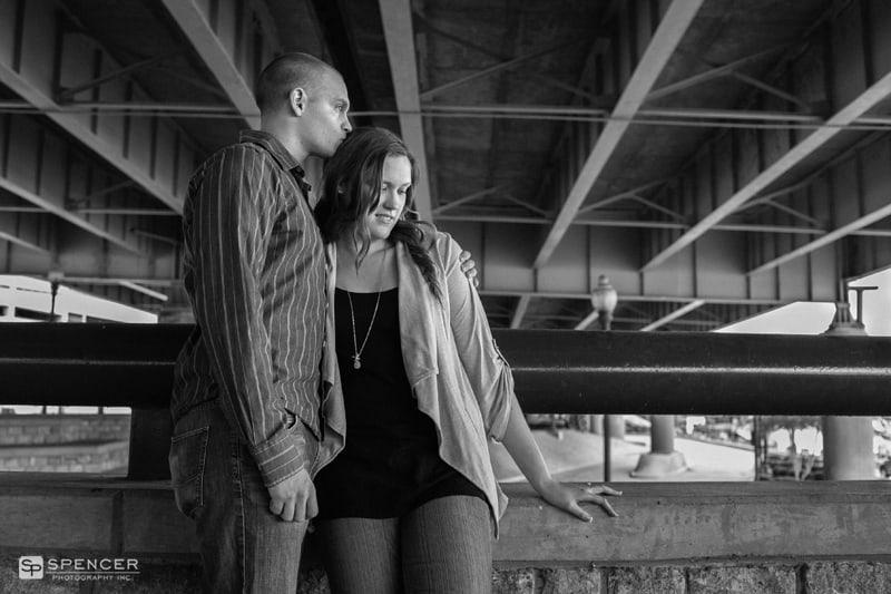 black and white engagement picture under a louisville bridge