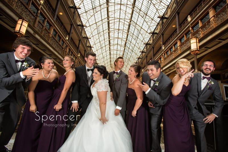 bridal party laughing at wedding at cleveland arcade