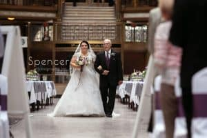 bride and dad walking down aisle at cleveland arcade wedding