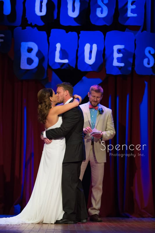 bride and groom kiss after their wedding ceremony at house of blues