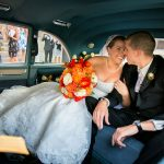 bride and groom kissing after wedding ceremony at old stone church in cleveland