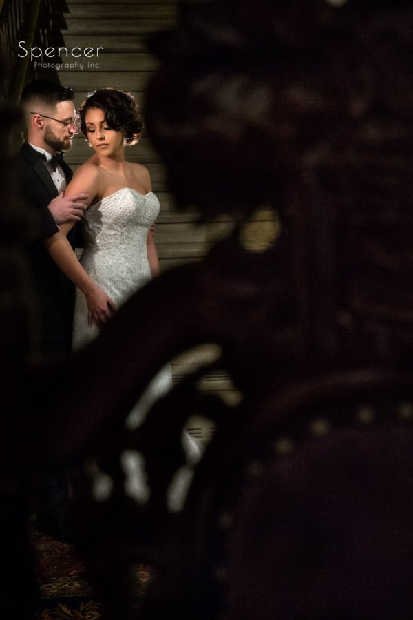 bride and groom picture thru a chair a crop bistro in cleveland