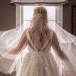 bride fluffs veil before her Cleveland wedding