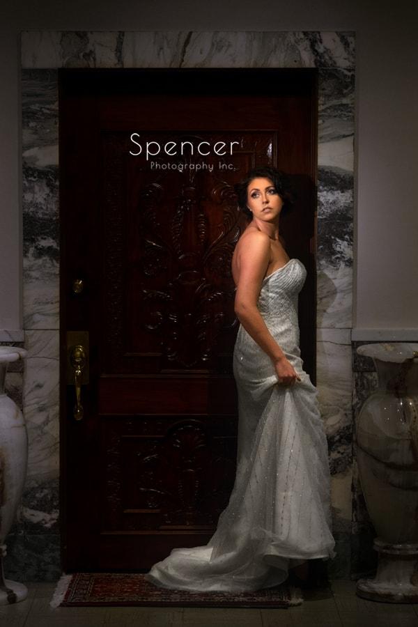 bride in wedding dress in doorway of Crop Bistro in Cleveland