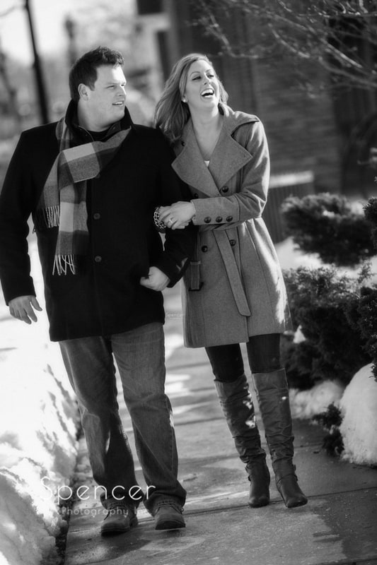 couple walking together during engagement pictures in hudson