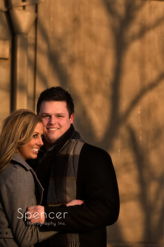 engagement picture in hudson with shadow of tree in background