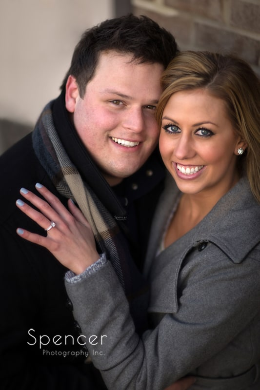 engagement picture of couple smiling into camera