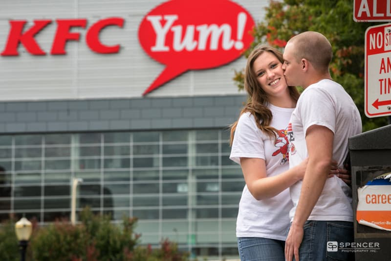 man kissing woman in front of Yum Center in Louisville Kentucky