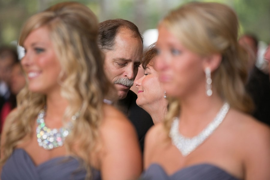 parents of bride kiss at wedding ceremony