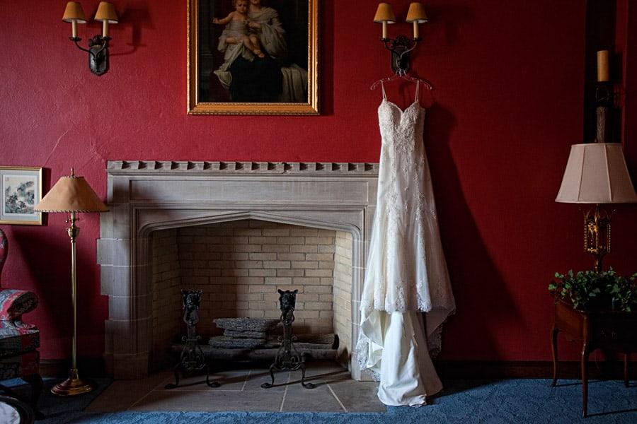 wedding dress hanging in suite of gervasi vineyard