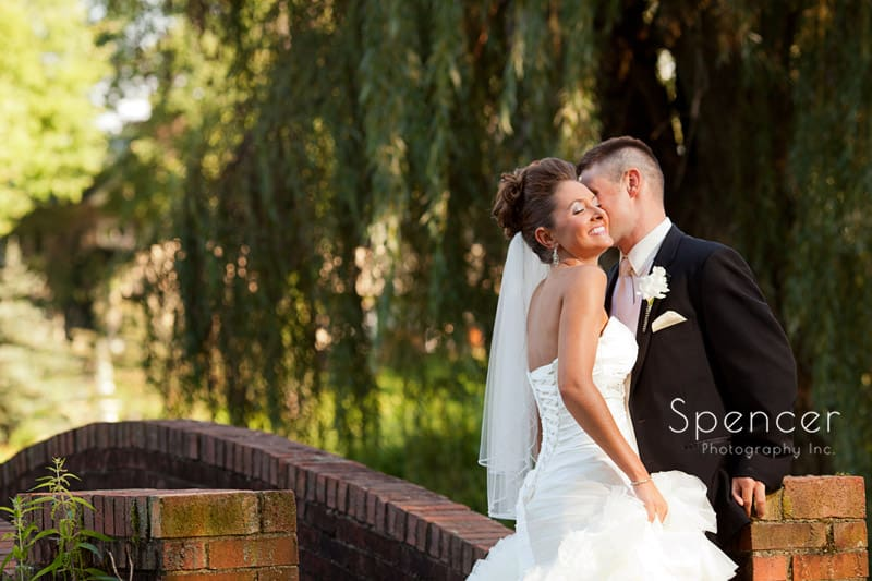 wedding picture on the bridge at Glenmoor Country Club