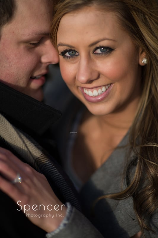 woman smiling into camera for her engagement pictures