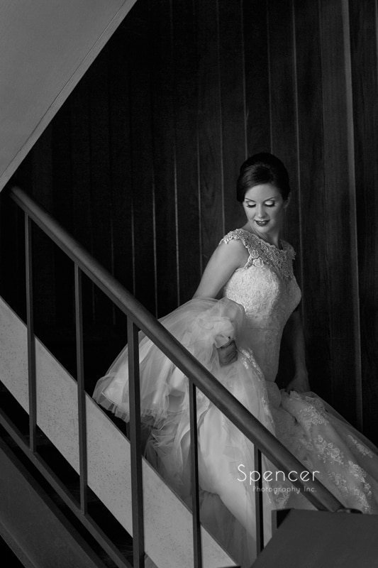 black and white picture of bride on chruch stairs