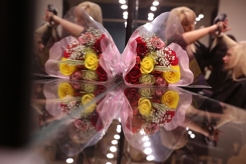 brides flowers in reflection at hair salon