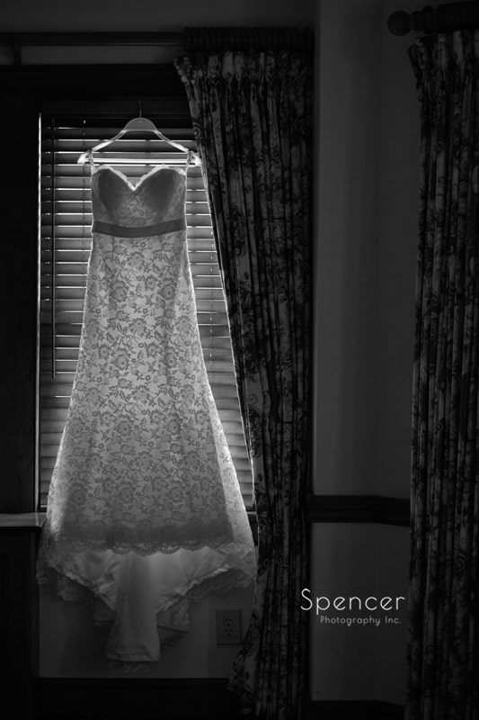 wedding dress hanging at Mayfield Country Club